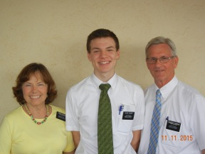 Elder Gilbert with mission President and sister Cosgrave.JPG